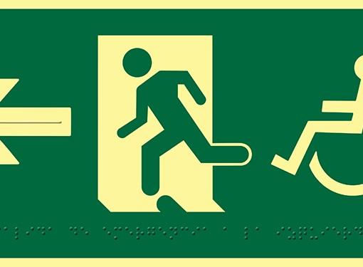 Pictograma salida de emergencia a la izquierda con silla de ruedas, en PVC luminiscente