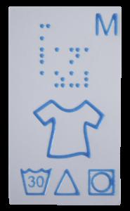 Etiqueta de ropa con braille y relieve